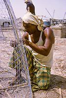Kuwait October 1966.  Kuwaiti Fisherman Mending Fish Traps at Sief.
