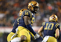 PHILADELPHIA, PA - DEC 14, 2019: Navy Midshipmen linebacker Nizaire Cromartie (56) celebrates a tackle for loss during game between Army and Navy at Lincoln Financial Field in Philadelphia, PA. The Midshipmen defeated Army 31-7. (Photo by Phil Peters/Media Images International)