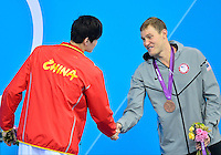 July 28, 2012: Yang Sun of China and Peter Vanderkaay USA shake hands at the conclusion of award ceremony for Men's 400m Freestyle event at the Aquatics Center on day one of 2012 Olympic Games in London, United Kingdom.
