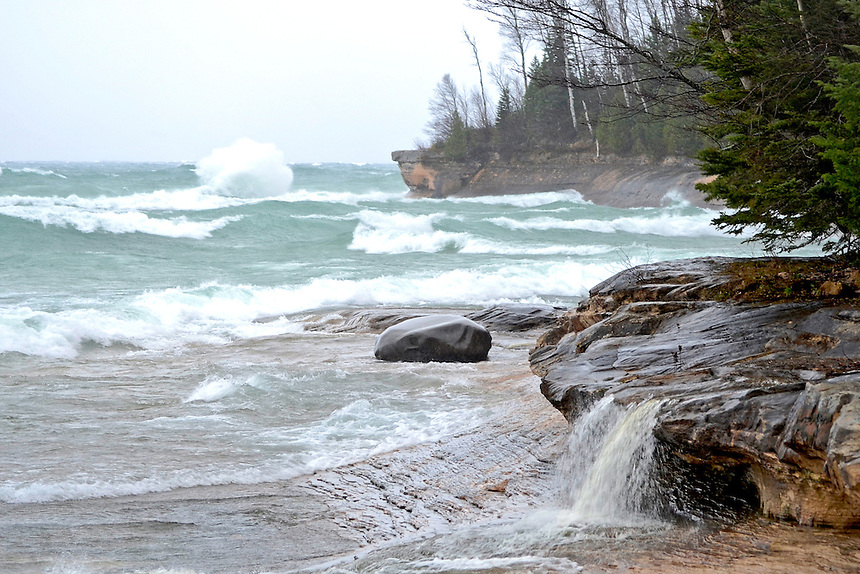 A small waterfall flowing into an active Lake Superior during the remnants of Hurricane Sandy. Miners Beach - Munising, MI - Pictured Rocks National Lakeshore