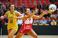 England's Rosie Ellison, right, gets the ball ahead of Australia's Bianca Chatfield in the New World Quad series netball match, TECT Arena, Tauranga, New Zealand, Sunday, October 28, 2012. Credit:NINZ / Dianne Manson.