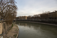 """River Tiber.<br /> <br /> Rome, 12/03/2020. Documenting Rome under the Italian Government lockdown for the Outbreak of the Coronavirus (SARS-CoV-2 - COVID-19) in Italy. On the evening of the 11 March 2020, the Italian Prime Minister, Giuseppe Conte, signed the March 11th Decree Law """"Step 4 Consolidation of 1 single Protection Zone for the entire national territory"""" (1.). The further urgent measures were taken """"in order to counter and contain the spread of the COVID-19 virus"""" on the same day when the WHO (World Health Organization, OMS in Italian) declared the coronavirus COVID-19 as a pandemic (2.).<br /> ISTAT (Italian Institute of Statistics) estimates that in Italy there are 50,724 homeless people. In Rome, around 20,000 people in fragile condition have asked for support. Moreover, there are 40,000 people who live in a state of housing emergency in Rome's municipality.<br /> March 11th Decree Law (1.): «[…] Retail commercial activities are suspended, with the exception of the food and basic necessities activities […] Newsagents, tobacconists, pharmacies and parapharmacies remain open. In any case, the interpersonal safety distance of one meter must be guaranteed. The activities of catering services (including bars, pubs, restaurants, ice cream shops, patisseries) are suspended […] Banking, financial and insurance services as well as the agricultural, livestock and agri-food processing sector, including the supply chains that supply goods and services, are guaranteed, […] The President of the Region can arrange the programming of the service provided by local public transport companies […]».<br /> Updates: on the 12.03.20 (6:00PM) in Italy there 14.955 positive cases; 1,439 patients have recovered; 1,266 died.<br /> <br /> Footnotes & Links:<br /> Info about COVID-19 in Italy: http://bit.do/fzRVu (ITA) - http://bit.do/fzRV5 (ENG)<br /> 1. March 11th Decree Law http://bit.do/fzREX (ITA) - http://bit.do/fzRFz (ENG)<br /> 2. http://bit.do/fzRKm"""