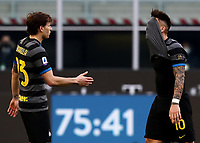 Calcio, Serie A: Inter Milano - Genoa , Giuseppe Meazza (San Siro) stadium, in Milan, February 28, 2021.  <br /> Inter's Lautaro Martinez (r) reacts while he leaves the pitch andi his teammate Nicolò Barella greets him (l) during the Italian Serie A football match between Inter and Genoa at Giuseppe Meazza (San Siro) stadium, on February 28, 2021.  <br /> UPDATE IMAGES PRESS/Isabella Bonotto