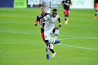 WASHINGTON, DC - NOVEMBER 8: Zachary Brault-Guillard #15 of Montreal Impact battles for the ball with Ola Kamara #9 of D.C. United during a game between Montreal Impact and D.C. United at Audi Field on November 8, 2020 in Washington, DC.