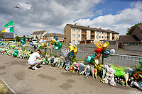 Pictured: A young man reads some of the tributes left in Balfe Road, in the Alway area of Newport, Wales, UK. Monday 14 June 2021<br /> Re: Three men and a boy have who have been charged with murdering a man and robbing him of a Gucci bag, have appeared before Magistrates Court in newport, Wales, UK.<br /> Ryan O'Connor, 26, who was known as Apple, died after being found unconscious and unresponsive in Balfe Road in the Alway area of Newport on Thursday at about 9pm.<br /> Lewis Aquilina, 19, Elliot Fiteni, 19, and Ethan Strickland, 18, all of Cardiff, appeared along with a 17-year-old boy at before Magistrates.<br /> Another 17-year-old boy, who cannot be named, faces the same charges.