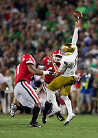ATHENS, GA - SEPTEMBER 21: Jermaine Johnson #11 of the Georgia Bulldogs and Travon Walker #44 pressure Ian Book #12 of the Notre Dame Fighting Irish into throwing an incomplete pass during a game between Notre Dame Fighting Irish and University of Georgia Bulldogs at Sanford Stadium on September 21, 2019 in Athens, Georgia.