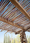 A mesquite arbor provides relief from the hot, Southwest sun.