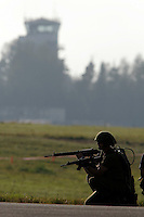 Norwegian Army soldiers during a tectivcal demo at Rygge Airshow. Control tower in background. Norway