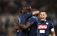 Calcio, Serie A: Roma, stadio Olimpico, 20 settembre 2017.<br /> Napoli's Kalidou Koulibaly (c) celebrates after scoring with his teammate Faouzi Ghoulam (l) and Marek Hamsik (r) during the Italian Serie A football match between Lazio and Napoli at Rome's Olympic stadium, September 20, 2017.<br /> UPDATE IMAGES PRESS/Isabella Bonotto