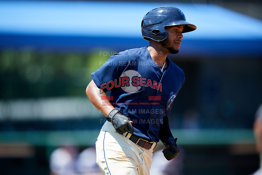 Mobile BayBears shortstop Alberto Triunfel (2) runs to first base during a game against the Pensacola Blue Wahoos on April 26, 2017 at Hank Aaron Stadium in Mobile, Alabama.  Pensacola defeated Mobile 5-3.  (Mike Janes/Four Seam Images)