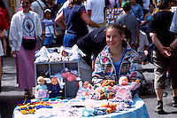 Young Artisan selling Hand-Crafted Doll Clothing at the Saturday Market in Ganges, on Saltspring Island, in the Southern Gulf Islands of British Columbia, Canada