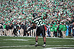 DENTON, TX  JANUARY 1:  Antoinne Jimmerson #22 of the North Texas Mean Green celebrates a touchdown against the UNLV Rebels during the Heart of Dallas Bowl at Cotton Bowl Stadium in Dallas on January 1, 2014 in Dallas, TX.  Photo by Rick Yeatts North Texas won 36-14 over UNLV.