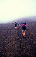 Hikers walk the rugged terrain at Haleakala National Park.