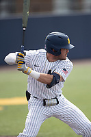 Michigan Wolverines third baseman Christian Mollfetta (14) at bat during NCAA baseball action against the Ohio State Buckeyes on April 10, 2021 at Ray Fisher Stadium in Ann Arbor, Michigan. The Wolverines defeated the Buckeyes 7-0. (Andrew Woolley/Four Seam Images)