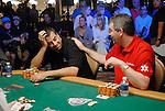 John Magill plays around with Dan Nassif, left.