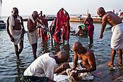 Hindu pilgrims wash their clothes and bathe on the ghats in the ancient city of Varanasi in Uttar Pradesh, India. Photograph: Sanjit Das/Panos