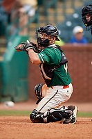 Greensboro Grasshoppers catcher Michael Hernandez (17) checks the runner while throwing the ball back to the pitcher during a game against the Lakewood BlueClaws on June 10, 2018 at First National Bank Field in Greensboro, North Carolina.  Lakewood defeated Greensboro 2-0.  (Mike Janes/Four Seam Images)