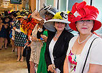 March 29, 2014: Hats and high fashion with a Mardi Gras flair were the focus on Louisiana Derby Day at the Fairgrounds Race Course in New Orleans, LA. Scott Serio/ESW/CSM