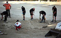 Pictured: Forensics officers assisted by Red Cross volunteers work at the farmhouse site where Ben Needham disappeared from in Kos, Greece. Tuesday 11 October 2016<br />Re: Police teams led by South Yorkshire Police are searching for missing toddler Ben Needham on the Greek island of Kos.<br />Ben, from Sheffield, was 21 months old when he disappeared on 24 July 1991 during a family holiday.<br />Digging has begun at a new site after a fresh line of inquiry suggested he could have been crushed by a digger.