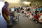 Gabe Kerschner introduces Izod, a North American alligator, to the crowd at a Wild Things program at the Carson City Library, in Carson City, Nev., on Wednesday, July 30, 2014. <br /> Photo by Cathleen Allison