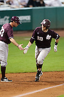Mississippi State Bulldog catcher Mitch Slauter #29 rounds third base after hitting a 10th inning home run against the LSU Tigers during the NCAA baseball game on March 16, 2012 at Alex Box Stadium in Baton Rouge, Louisiana. LSU defeated Mississippi State 3-2 in 10 innings. (Andrew Woolley / Four Seam Images)