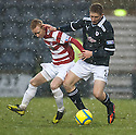 Accies Alister Crawford and Raith's Jason Thomson challenge for the ball.