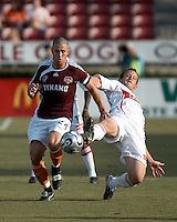 Houston Dynamo defender Wade Barrett (24) attempts to maintain control of the ball as Chicago Fire forward Chad Barrett (9) comes in for the tackle.  Chicago Fire beat Houston Dynamo 1-0 at Robertson Stadium in Houston, TX on April 29, 2007.