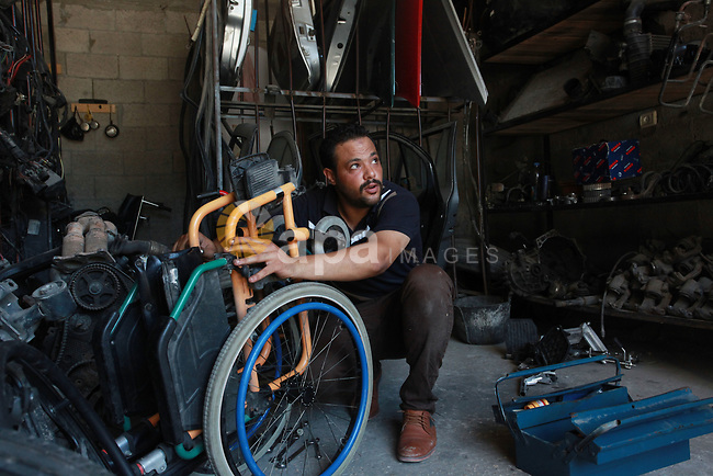 Palestinian youths work in wheelchairs repair at their workshop, in Gaza City, on July 10, 2021. A youth initiative to repair wheelchairs for people with disabilities free of charge in the Gaza Strip. 93 Thousands Persons with disabilities in Palestine. About one fifth of persons with disabilities are children under the age of 18. Photo by Omar Ashtawy