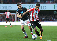 Ollie Watkins of Brentford shields the ball from Middlesbrough's Lewis Wing during Brentford vs Middlesbrough, Sky Bet EFL Championship Football at Griffin Park on 8th February 2020