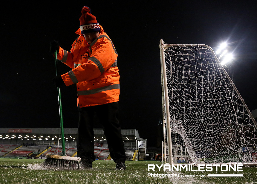 Ground Staff clear snow from the picth ahead of the SSE Airtricity League Premier Division game between Bohemians and Derry City on Tuesday 27th February 2018 at Dalymount Park, Dublin. Photo By: Michael P Ryan