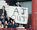"""Kilmarnock fans wave an """"AJ OUT"""" banner as they leave Tynecastle after the fourth goal."""