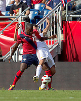 USA forward Jozy Altidore (17) and Spain midfielder Sergio Busquets (16) battle for the ball. In a friendly match, Spain defeated USA, 4-0, at Gillette Stadium on June 4, 2011.
