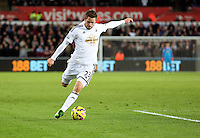 Pictured: Gylfi Sigurdsson of Swansea Saturday 10 January 2015<br /> Re: Barclays Premier League, Swansea City FC v West Ham United at the Liberty Stadium, south Wales, UK