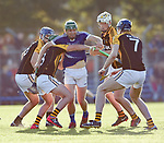 Cathal Mc Inerney of Cratloe is stopped by four  Ballyea players during the county senior hurling final at Cusack Park. Photograph by John Kelly.
