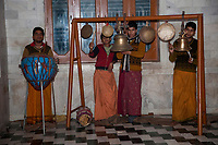 India, Rishikesh.  Young Men Playing Gongs, Bells, and Drum in Hindu Temple.