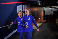JACKSONVILLE, FL - NOVEMBER 10: Mallory Pugh #2 and Morgan Brian #6 of the United States walk out on to the field to warm up during a game between Costa Rica and USWNT at TIAA Bank Field on November 10, 2019 in Jacksonville, Florida.
