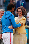 Queen Sofia of Spain presents the runners up trophy to Rafael Nadal of Spain after losing to Andy Murray of Britain during the men's final at the Madrid Open Tennis tournament in Madrid, Spain. May 10, 2015. (ALTERPHOTOS/Victor Blanco)