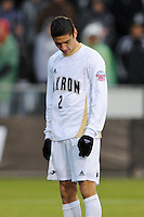 Akron Zips Zarek Valentin (2) reacts after failing to convert a penalty kick during the penalty kick shootout. The Virginia Cavaliers defeated the Akron Zips 3-2 in a penalty kick shoot out after a scoreless game and overtime in the finals of the 2009 NCAA Men's College Cup at WakeMed Soccer Park in Cary, NC on December 13, 2009.