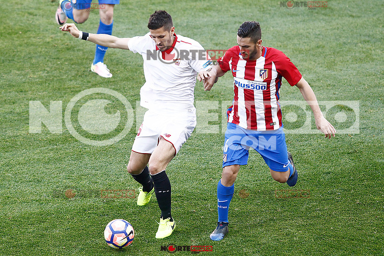 Atletico de Madrid's Koke Resurrecccion (r) and Sevilla FC's Stevan Jovetic during La Liga match. March 19,2017. (ALTERPHOTOS/Acero) /NORTEPHOTO.COM