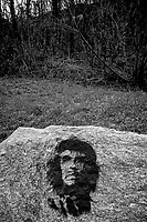 """Switzerland. Canton Ticino. Lugano. The portrait of Ernesto Che Guevara is painted on a rock close to the forest. The original image was taken by the photographer Alberto Korda and entitled the Guerrillero Heroico (Heroic Guerrilla Fighter). It is an iconic photograph of Marxist revolutionary. It was captured on March 5, 1960, in Havana, Cuba, at a memorial service for victims of the La Coubre explosion. Ernesto """"Che"""" Guevara (14 June 1928 – 9 October 1967) was an Argentine Marxist revolutionary, physician, author, guerrilla leader, diplomat, and military theorist. A major figure of the Cuban Revolution, his stylized visage has become a ubiquitous countercultural symbol of rebellion and global insignia in popular culture. 8.03.2020  © 2020 Didier Ruef"""