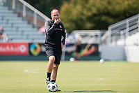 CARY, NC - SEPTEMBER 12: Portland Thorns head coach Mark Parsons whistles an end to a warm-up session before a game between Portland Thorns FC and North Carolina Courage at WakeMed Soccer Park on September 12, 2021 in Cary, North Carolina.