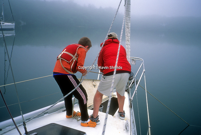 Raising the anchor on a sailboat in Phippsburg, Maine, USA