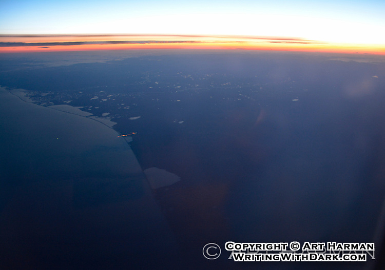 The coast of Alaska at sunset, flying home from Asia.
