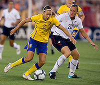 Abby Wambach, Charlotte Rohlin. The USWNT defeated Sweden, 3-0.