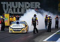 Jun 19, 2015; Bristol, TN, USA; NHRA funny car driver Allen Johnson during qualifying for the Thunder Valley Nationals at Bristol Dragway. Mandatory Credit: Mark J. Rebilas-