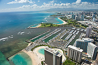 Aerial of Ala Wai boat harbor with Hilton Hwn Village, Magic Island and Ala Moana Shopping Center