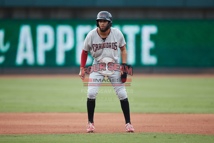 Jonathan Ornelas (3) of the Hickory Crawdads takes his lead off of second base against the Winston-Salem Dash at Truist Stadium on July 7, 2021 in Winston-Salem, North Carolina. (Brian Westerholt/Four Seam Images)