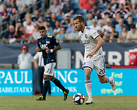 FOXBOROUGH, MA - JULY 27: Oriol Rosell #20 dribbles during a game between Orlando City SC and New England Revolution at Gillette Stadium on July 27, 2019 in Foxborough, Massachusetts.