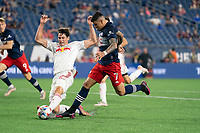 FOXBOROUGH, MA - MAY 22: Sean Nealis #15 of New York Red Bulls tries to deflect the ball from Gustavo Bou #7 of New England Revolution near the New York Red Bulls goal during a game between New York Red Bulls and New England Revolution at Gillette Stadium on May 22, 2021 in Foxborough, Massachusetts.