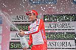 Alexander Krisoff (NOR) Katusha sprays the bubbly after winning the rain soaked 294km 105th Milano-Sanremo 2014, Sanremo, Italy. 23rd March 2014.     <br /> Photo: Gian Mattia D'Alberto/LaPresse/www.newsfile.ie